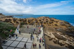 Many tourists walk around the stone Strange shape at Yehliu Geop Royalty Free Stock Photo