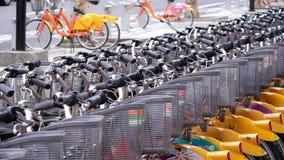 Motion of public rental bike call ubike beside building. Ubike is a popular network of rental bicycle in Taipei, Taiwan. stock video