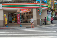 TAIPEI, TAIWAN - NOVEMBER 30, 2016: Taipei Street in one of suburb, district. Girl is Waiting Green Light. Stock Images
