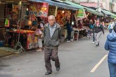 TAIPEI, TAIWAN - NOVEMBER 30, 2016: Taipei Street in one of suburb, district. Market Street in Taipei. Royalty Free Stock Photo