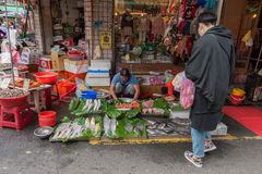 TAIPEI, TAIWAN - NOVEMBER 30, 2016: Taipei Street in one of suburb, district. Market Street in Taipei. Selling Fish Royalty Free Stock Photo