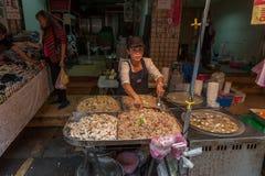 TAIPEI, TAIWAN - NOVEMBER 30, 2016: Taipei Street in one of suburb, district. Market Street in Taipei. Selling Food. Stock Photos