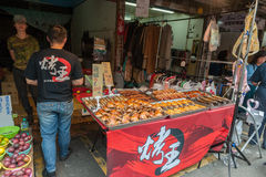 TAIPEI, TAIWAN - NOVEMBER 30, 2016: Taipei Street in one of suburb, district. Market Street in Taipei. Selling Fried Chickens Stock Photo