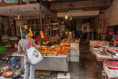 TAIPEI, TAIWAN - NOVEMBER 30, 2016: Taipei Street in one of suburb, district. Market Street in Taipei. Selling Fried Chickens Stock Image
