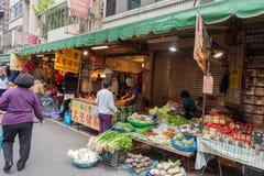 TAIPEI, TAIWAN - NOVEMBER 30, 2016: Taipei Street in one of suburb, district. Market Street in Taipei. Selling Vegetables. Stock Image