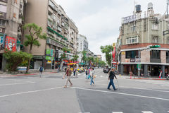 TAIPEI, TAIWAN - NOVEMBER 30, 2016: Taipei Street in one of suburb, district. People Crossing the Street. Taipei Street in one of suburb, district. People Royalty Free Stock Image