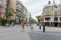 TAIPEI, TAIWAN - NOVEMBER 30, 2016: Taipei Street in one of suburb, district. People Crossing the Street. Taipei Street in one of suburb, district. People Stock Photo