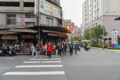 TAIPEI, TAIWAN - NOVEMBER 30, 2016: Taipei Street in one of suburb, district. People Crossing Street. Stock Photo