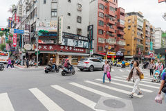 TAIPEI, TAIWAN - NOVEMBER 30, 2016: Taipei Street in one of suburb, district. People Crossing the Street. Taipei Street in one of suburb, district. People Royalty Free Stock Photo