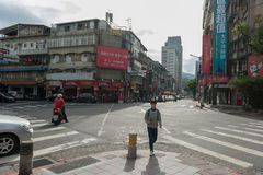 TAIPEI, TAIWAN - NOVEMBER 30, 2016: Taipei Street in one of suburb, district. People Crossing Street. Royalty Free Stock Photos