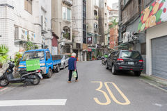 TAIPEI, TAIWAN - NOVEMBER 30, 2016: Taipei Street in one of suburb, district. People Crossing Street. Royalty Free Stock Images