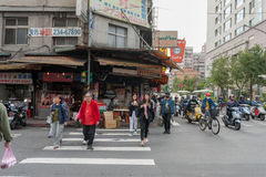TAIPEI, TAIWAN - NOVEMBER 30, 2016: Taipei Street in one of suburb, district. People Crossing Street. Royalty Free Stock Photo