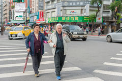 TAIPEI, TAIWAN - NOVEMBER 30, 2016: Taipei Street in one of suburb, district. People Crossing Street. Royalty Free Stock Photography