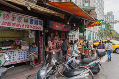 TAIPEI, TAIWAN - NOVEMBER 30, 2016: Taipei Street in one of suburb, district. People Selling Food. Meat, Newspapers Stock Photo
