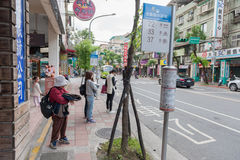 TAIPEI, TAIWAN - NOVEMBER 30, 2016: Taipei Street in one of suburb, district. People Waiting for Bus. Royalty Free Stock Photo