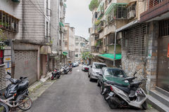 TAIPEI, TAIWAN - NOVEMBER 30, 2016: Taipei Street in one of suburb, district. Scooters and House in Background. Royalty Free Stock Photos