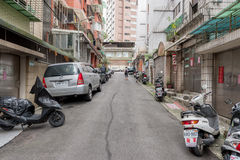TAIPEI, TAIWAN - NOVEMBER 30, 2016: Taipei Street in one of suburb, district. Scooters and House in Background. Stock Photos