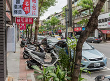 TAIPEI, TAIWAN - NOVEMBER 30, 2016: Taipei Street in one of suburb, district. Scooters Parking Area. Stock Images
