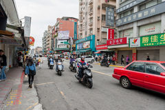 TAIPEI, TAIWAN - NOVEMBER 30, 2016: Taipei Street in one of suburb, district. Scooters on the street Royalty Free Stock Image