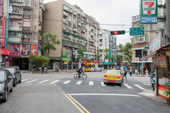 TAIPEI, TAIWAN - NOVEMBER 30, 2016: Taipei Street in one of suburb, district. Shops and People. Living House. Taipei Street in one of suburb, district. Shops stock photos