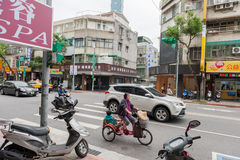 TAIPEI, TAIWAN - NOVEMBER 30, 2016: Taipei Street in one of suburb, district. Woman on Bicycle. Royalty Free Stock Photography