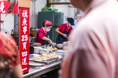 TAIPEI,TAIWAN - OCTOBER 10,2017 : Women cooking traditional food in in Jiufen market is a neighborhood and shopping ,street-food s Stock Photography