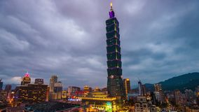 Taipei, Taiwan at Taipei101. TAIPEI, TAIWAN - FEBRUARY 26, 2017: Taipei 101 towers over the Xinyi District from dusk to night. The skyscraper was briefly the stock footage