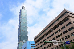 Taipei 101 tower by the road. Low angle view of taipei 101 financial center in cloudy day, taiwan royalty free stock photos