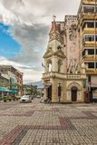 Clock tower at main square in the town of Taiping, Malaysia. Taiping, Malaysia - December 10, 2017: Traffic at the street corner with colonial style clock tower Royalty Free Stock Photography