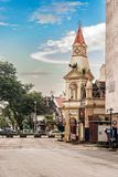 Clock tower at main square in the town of Taiping, Malaysia. Taiping, Malaysia - December 10, 2017: Traffic at the street corner with colonial style clock tower Royalty Free Stock Photo