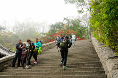 Taishan Tourists. Chinese tourists climbing up and down the stone steps of Mount Tai (taishan) on a foggy morning in Shandong province China stock photography