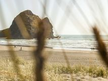 Taitomo Island Piha Beach, Auckland, NZ stock images