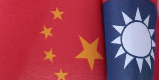 Taiwan and China flags. Curving flags of Taiwan and China stock photos