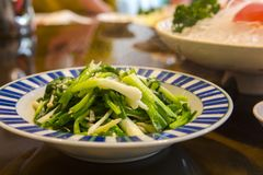 Taiwan, Chinese food, fried vegetables, green onion beads Stock Photos