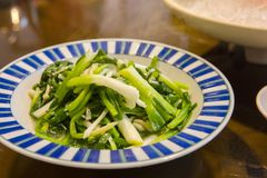 Taiwan, Chinese food, fried vegetables, green onion beads Royalty Free Stock Images