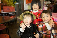 Taiwanese indigenous siblings pose in front the camera stock image