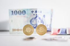 50 Taiwan dollar coins and banknotes. 50 Taiwan dollar coins with banknotes on background stock photography