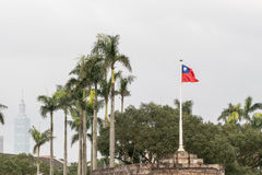 Taiwan flag blowing in wind. Motion blur, with Taipei 101 in the background stock photo
