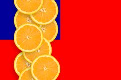 Taiwan flag and citrus fruit slices vertical row. Taiwan flag and vertical row of orange citrus fruit slices. Concept of growing as well as import and export of stock images
