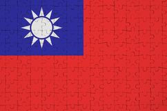 Taiwan flag is depicted on a folded puzzle royalty free stock images