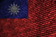 Taiwan flag is depicted on the screen with the program code. The concept of modern technology and site development.  royalty free illustration