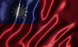 Wallpaper by Taiwan flag and waving flag by fabric. Taiwan flag - Fabric flag of Taiwan country, Background and wallpaper of waving flag by textile royalty free stock image