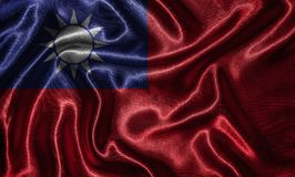 Wallpaper by Taiwan flag and waving flag by fabric. Taiwan flag - Fabric flag of Taiwan country, Background and wallpaper of waving flag by textile royalty free stock photo