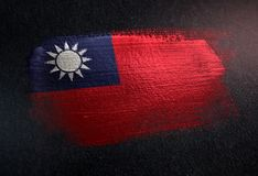 Taiwan Flag Made of Metallic Brush Paint on Grunge Dark Wall.  royalty free stock photos