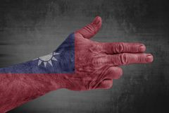 Taiwan flag painted on male hand like a gun royalty free stock photos