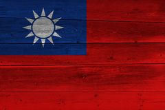 Taiwan flag painted on old wood plank. Patriotic background. National flag of Taiwan stock photo