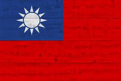 Taiwan flag painted on old wood plank. Patriotic background. National flag of Taiwan stock images