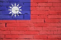 Taiwan flag is painted onto an old brick wall royalty free stock photography