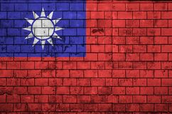 Taiwan flag is painted onto an old brick wall royalty free illustration