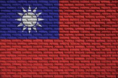 Taiwan flag is painted onto an old brick wall stock photo